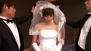 A Japanese bride wears her wedding gown while bouncing on a gumshoe