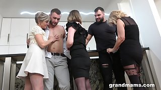 Several bodily grannies fuck two handsome and young men