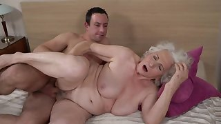 Grey-haired female gets her hairy cunt fucked away from younger boy