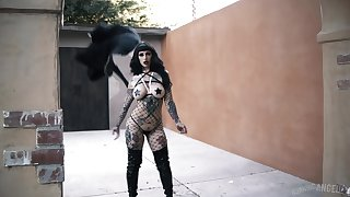 Tattooed goth teen babe Jessie Lee eats cum after a doggy style fuck