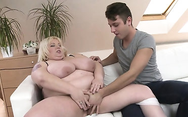 Heavy breasted BBW rendering her toyboy